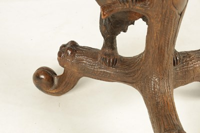 Lot 969 - A LATE 19TH CENTURY SWISS CARVED BLACK FOREST...