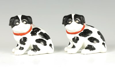 Lot 33 - A PAIR OF CONTINENTAL SEATED PUG DOGS