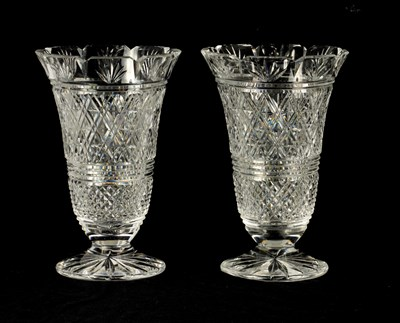 Lot 13 - A GOOD PAIR OF WATERFORD CUT CRYSTAL TRUMPET-SHAPED FOOTED VASES